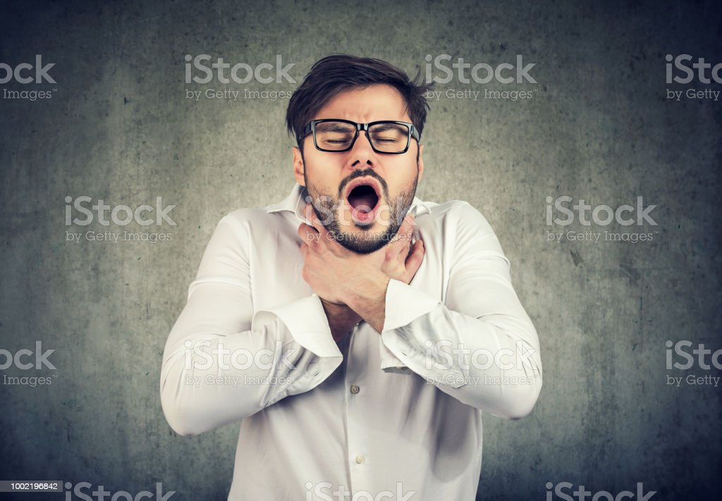 Young man having asthma attack stock photo