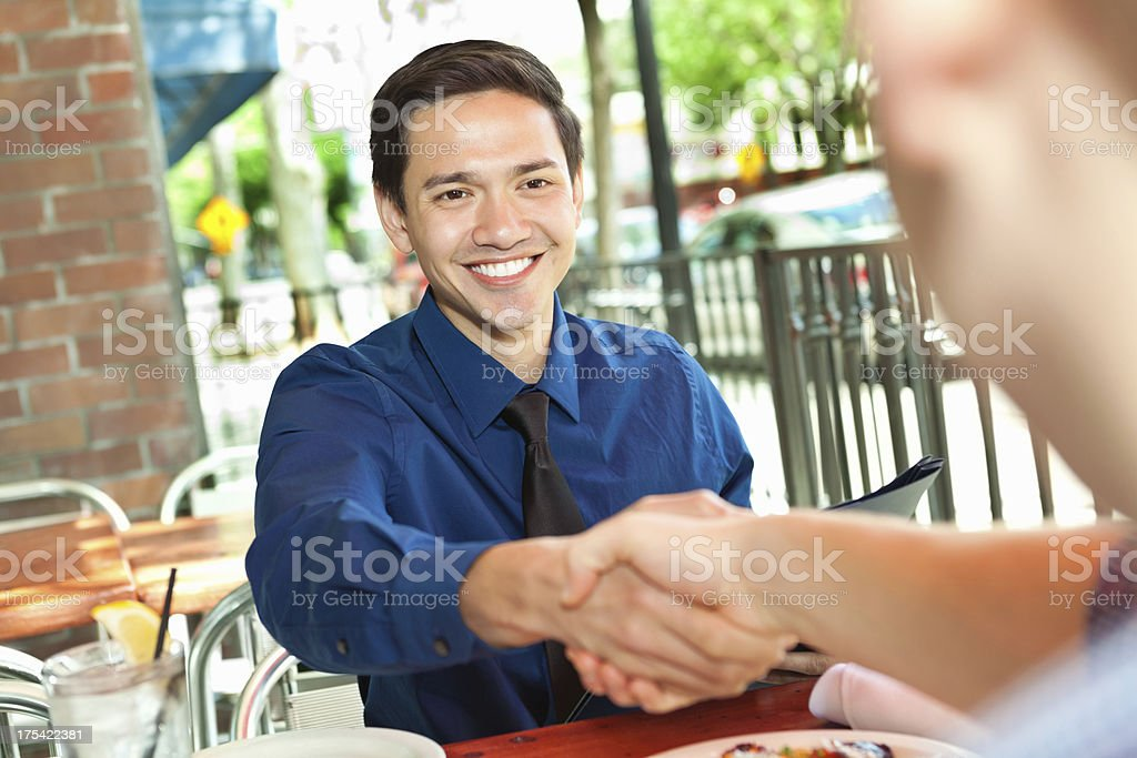 Young man having business meeting at outdoor cafe royalty-free stock photo
