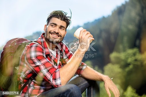 istock Young man having coffee break during mountain hiking 546422714