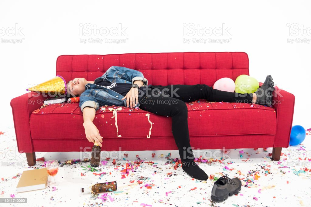 Young man having hangover after new year party, sleeping with chaos...