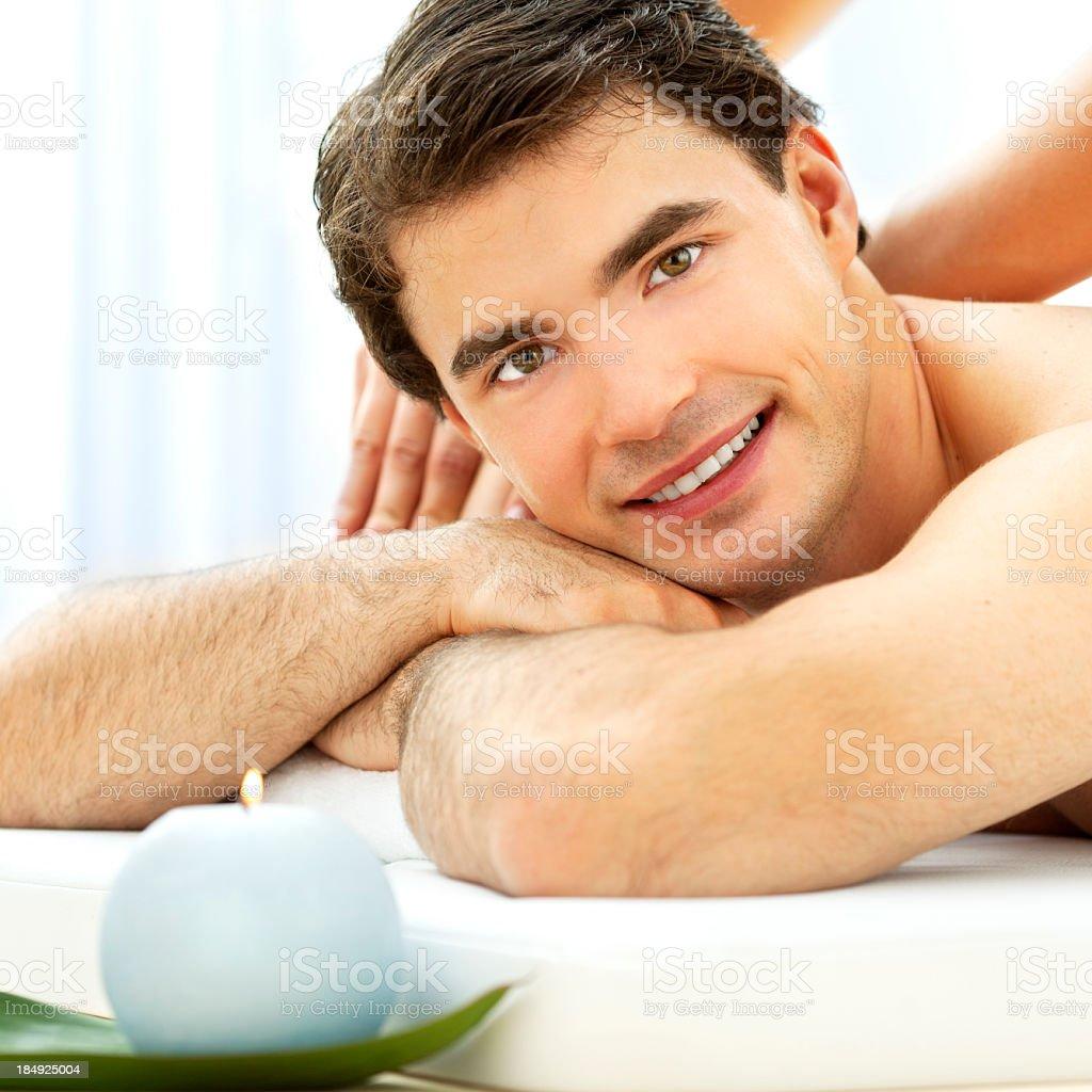 Young Man Having Massage At Spa Center royalty-free stock photo