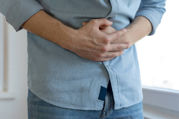 Young man having stomach ache stock photo
