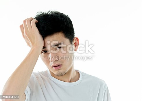534891769 istock photo Young man headache against white background 590034170