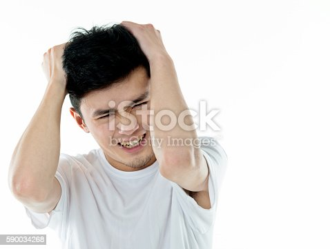 534891769 istock photo Young man headache against white background 590034268