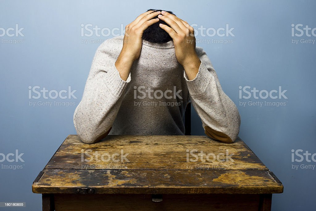 Young man hiding in his jumper royalty-free stock photo