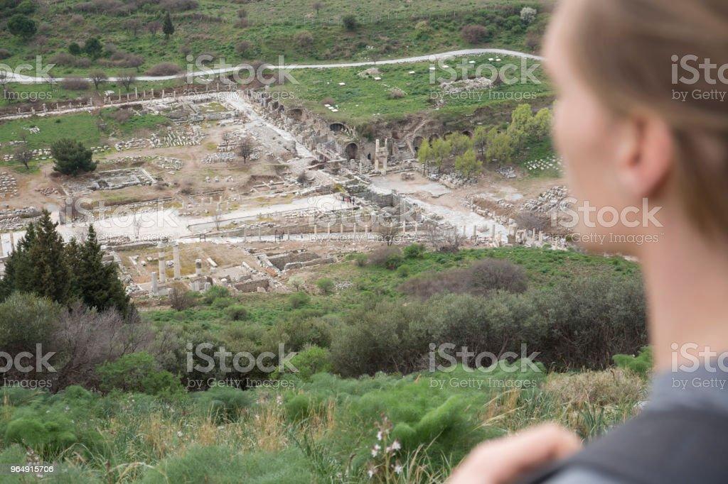 Young man hikes through ruins royalty-free stock photo