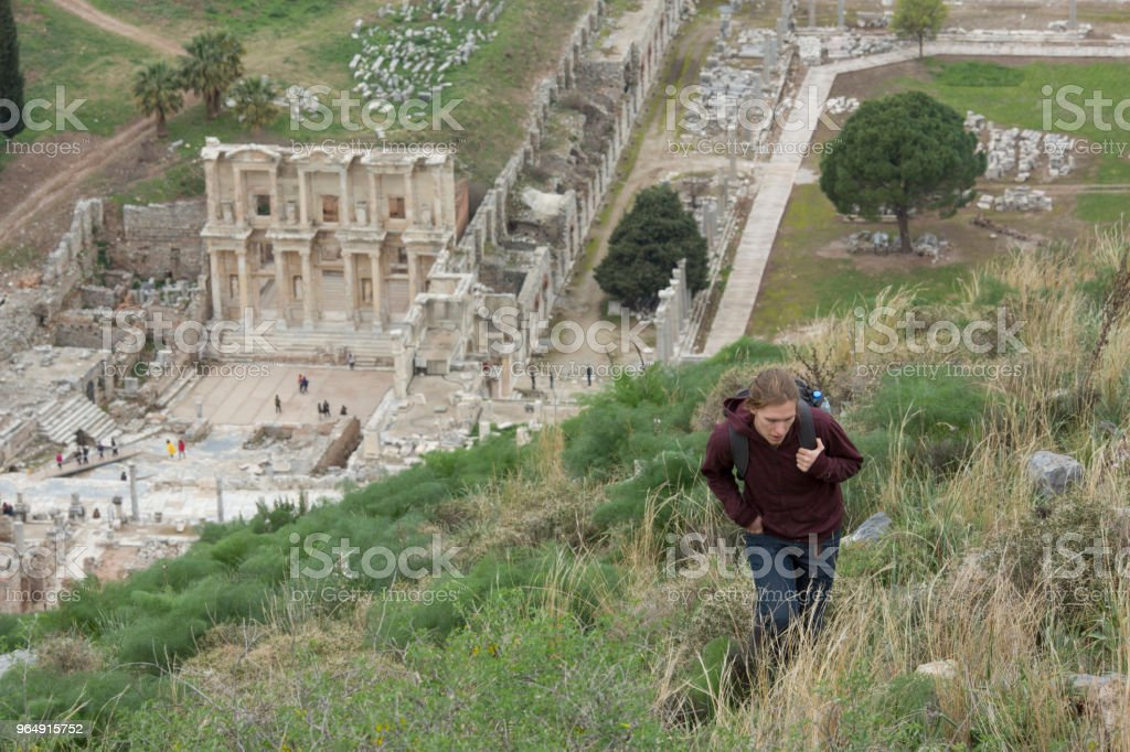 Young man hikes through ruins royalty-free stock photo