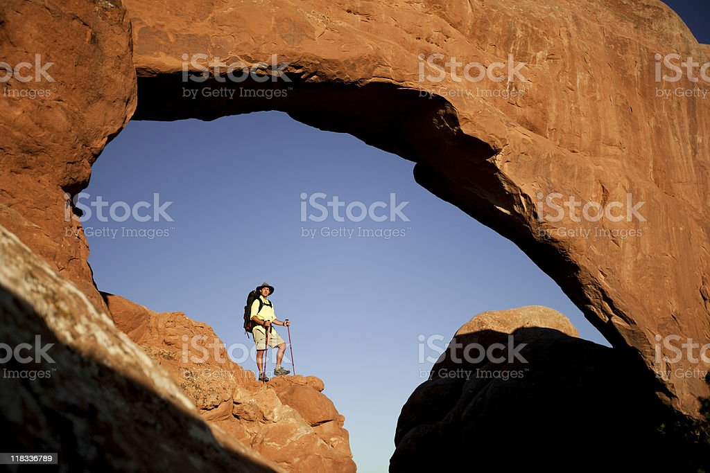 Young Man Hiking In Arches National Park royalty-free stock photo