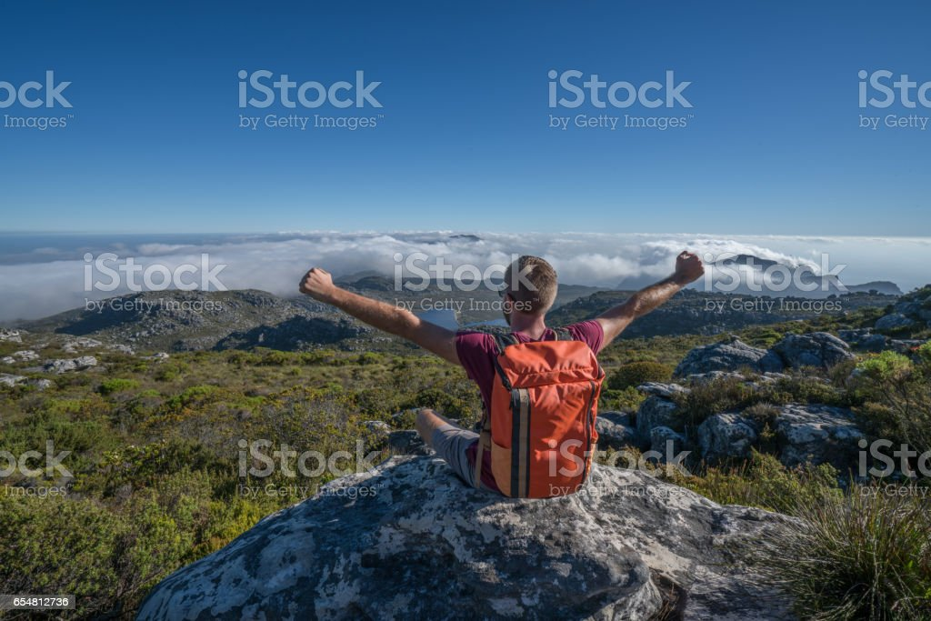 Young Man Hiking In Cape Town Arms Outstretched On