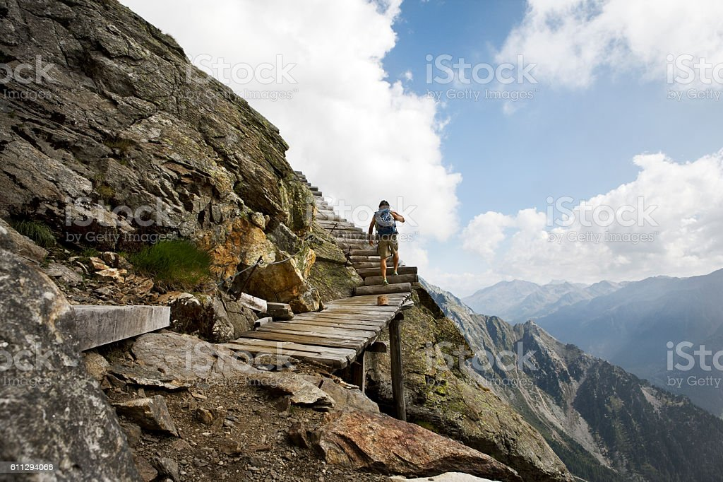 young man hiking in scenic mountain landscape of Dolomite Alps stock photo