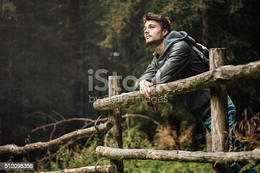 istock Young man hiking in the forest 512098356