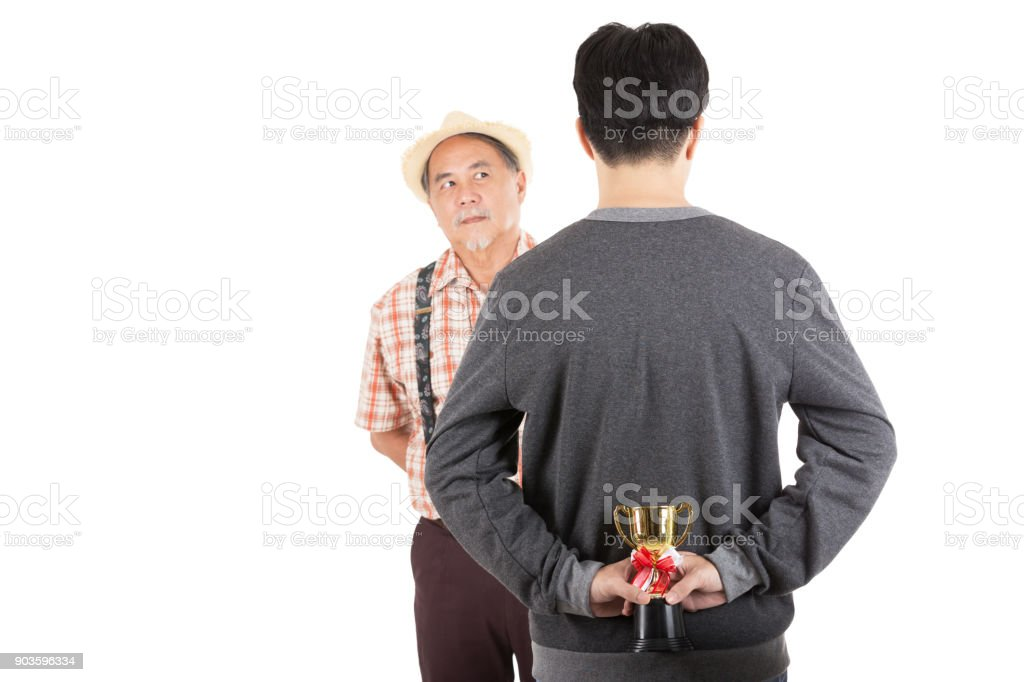 young man hold a trophy stock photo