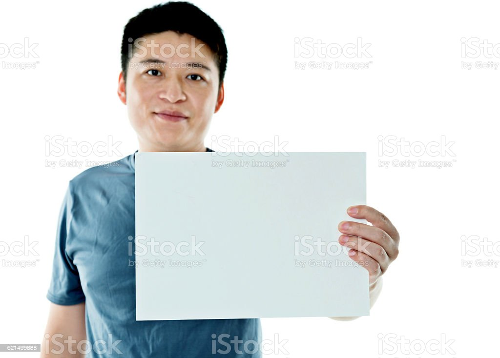 Young man holding a blank paper photo libre de droits