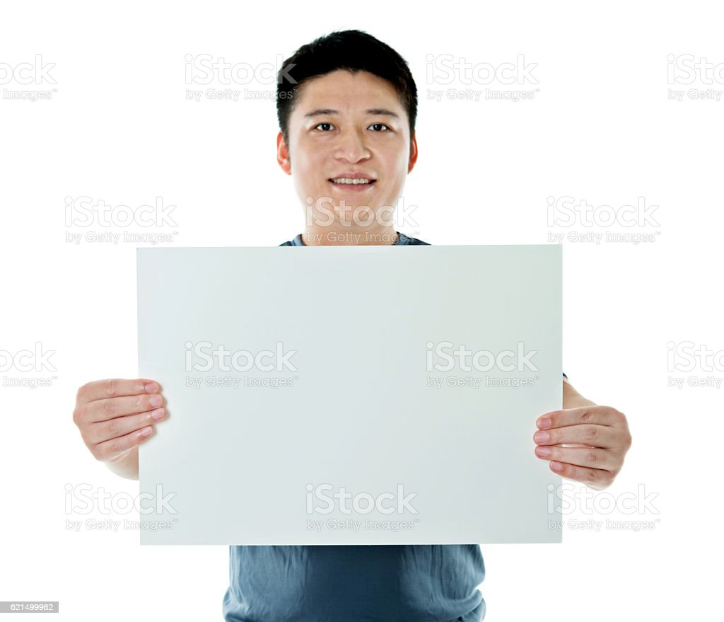 Young man holding a blank paper foto stock royalty-free