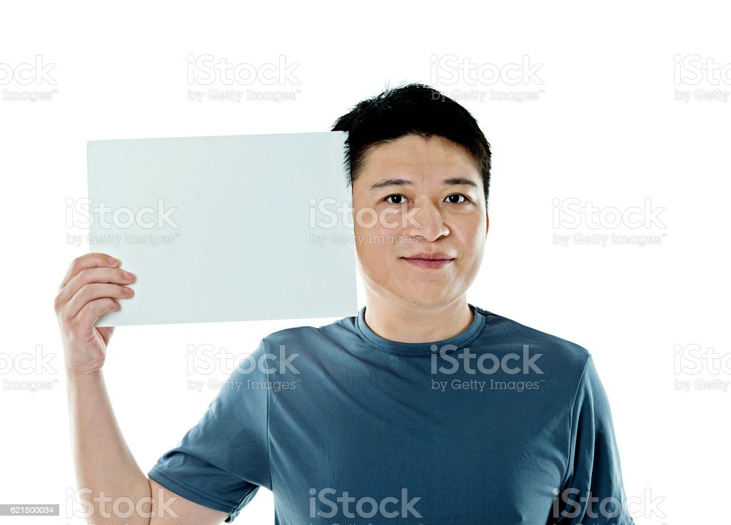 Young man holding a blank paper photo libre de droits
