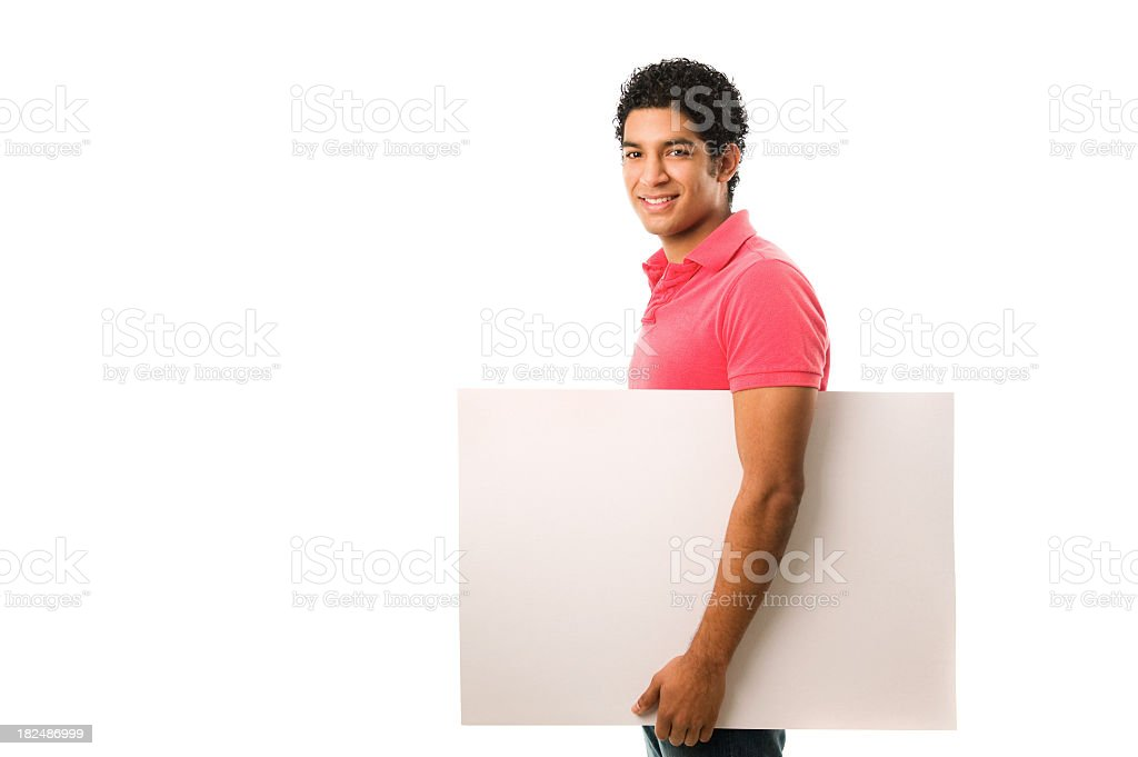 Young man holding a blank placard royalty-free stock photo