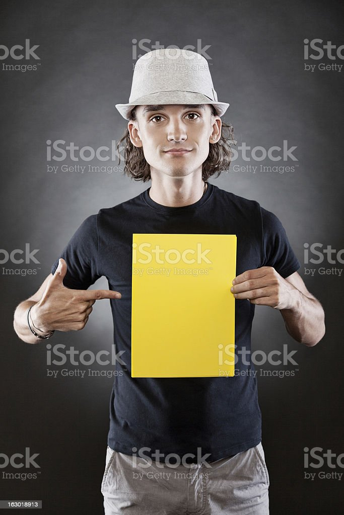Young man holding a blank sign royalty-free stock photo