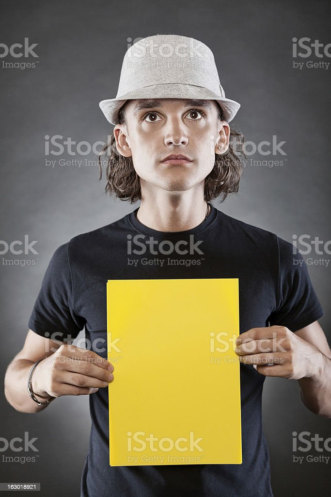 Young man holding a blank sign stock photo