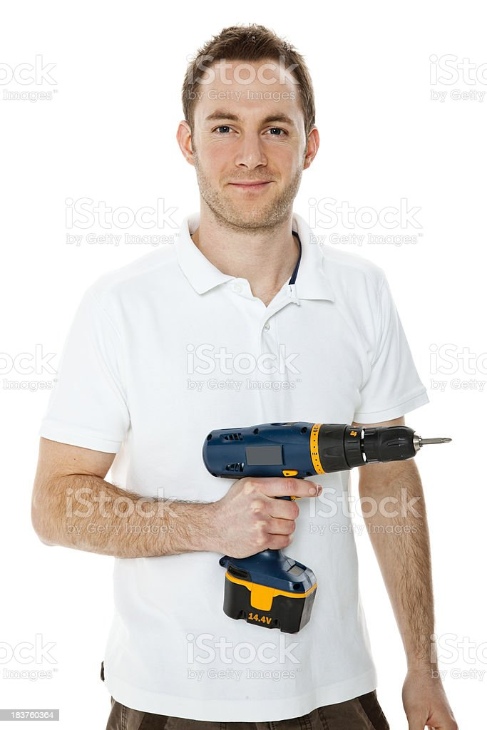 Young man holding a drill isolated on white background royalty-free stock photo