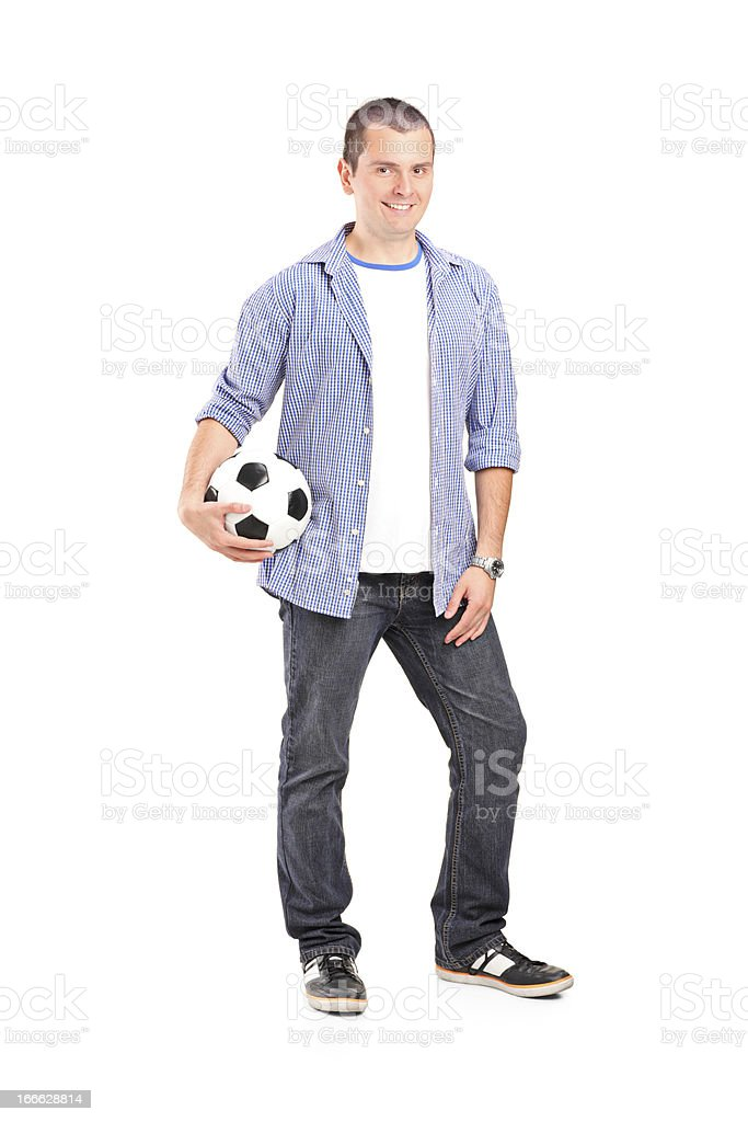Young man holding a football royalty-free stock photo