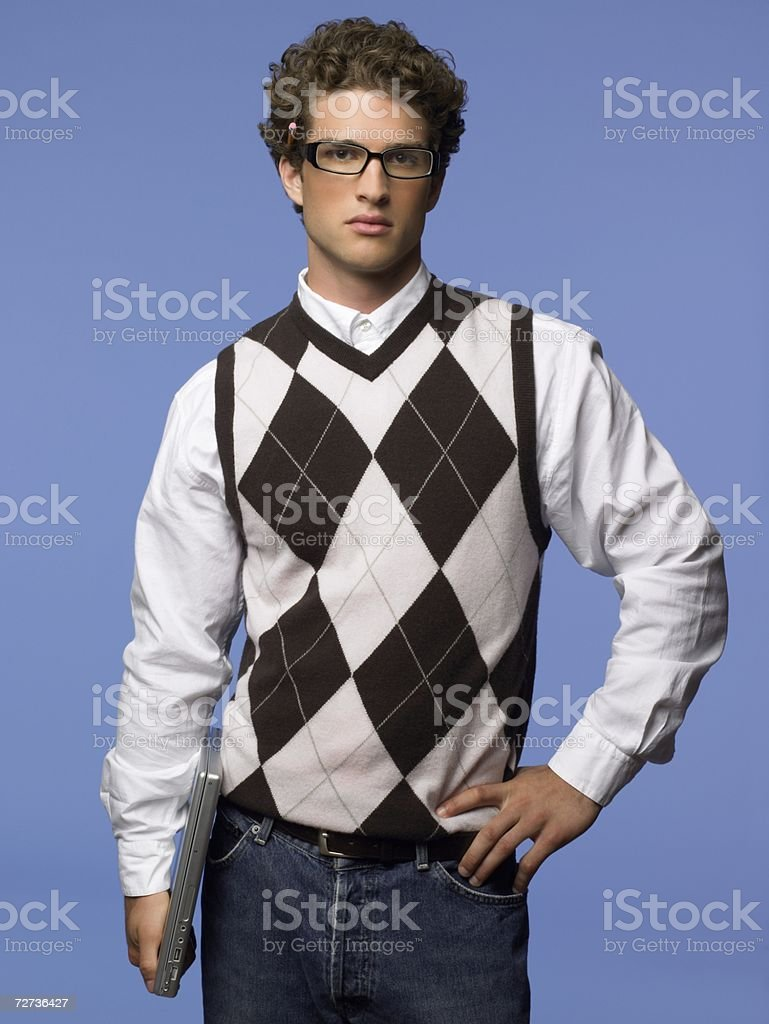 Young man holding a laptop computer stock photo