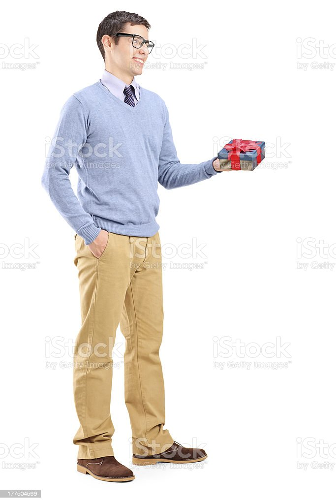 Young man holding a present royalty-free stock photo