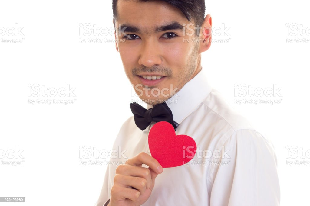 Young man holding a read heart royalty-free stock photo