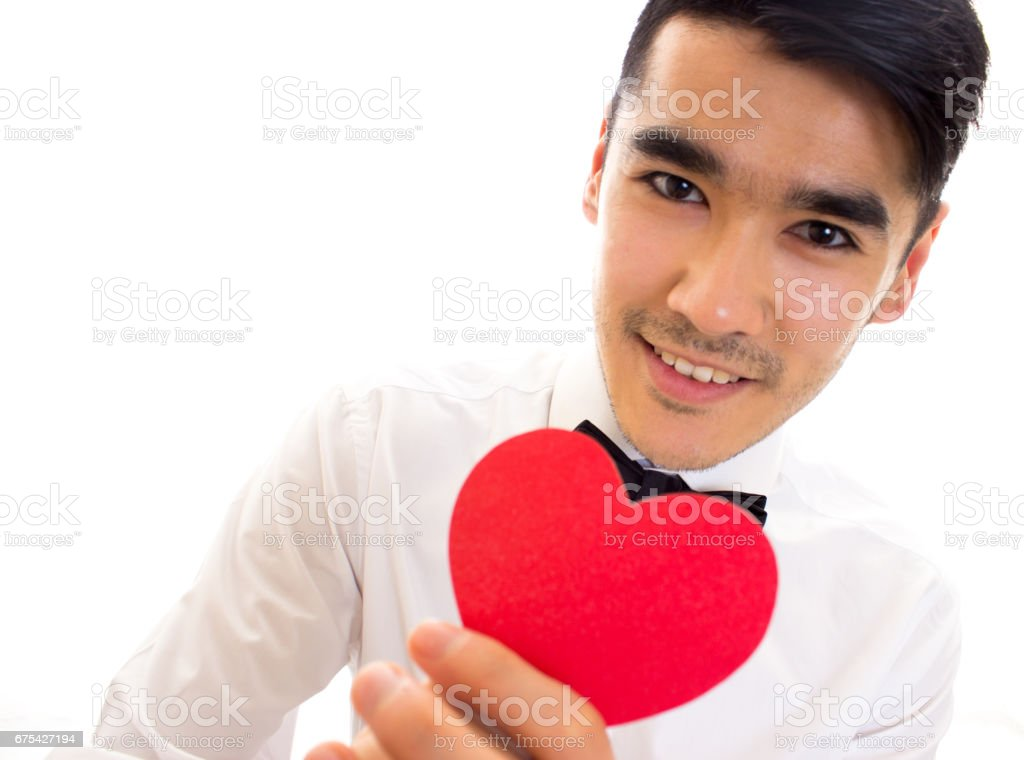 Young man holding a read heart photo libre de droits