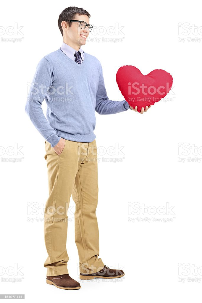 Young man holding a red heart royalty-free stock photo