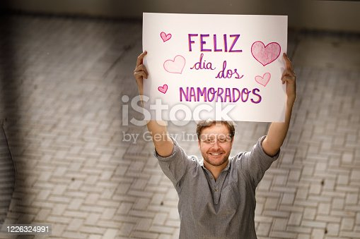 Man holding a valentine's day poster.