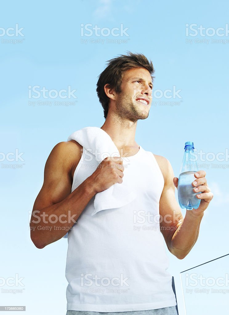 A young man holding a water bottle royalty-free stock photo