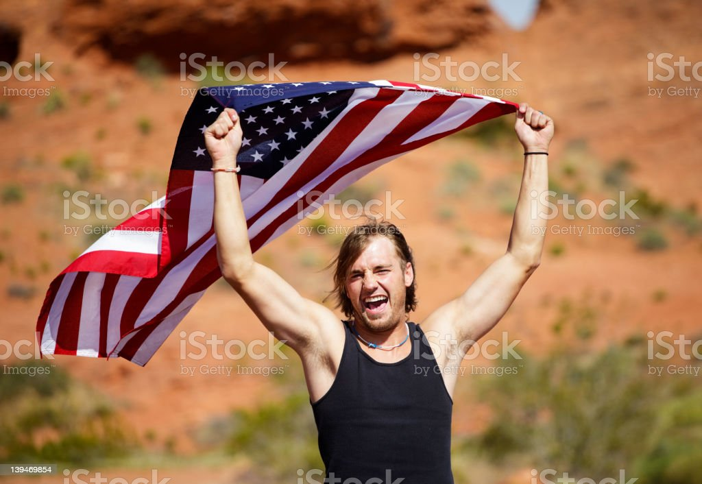 Young Man Holding American Flag royalty-free stock photo