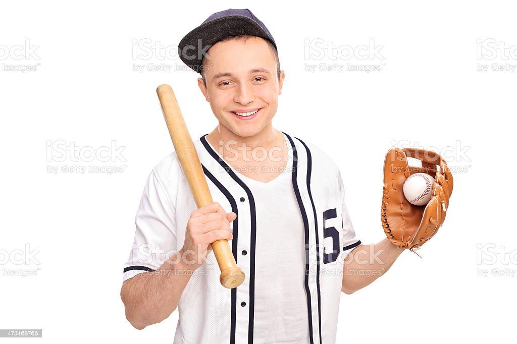 Young man holding baseball bat and a ball stock photo