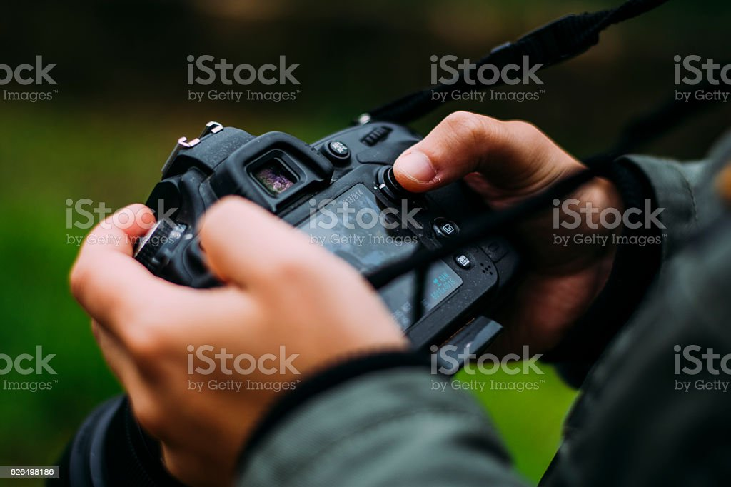 Young man holding camera royalty-free stock photo