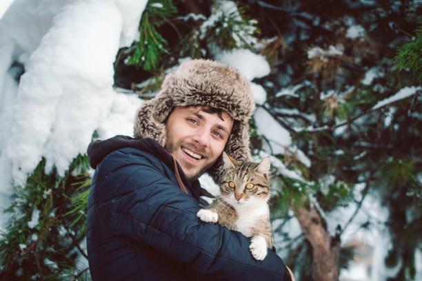 Young man holding catsnowing picture id1085067030?b=1&k=6&m=1085067030&s=612x612&w=0&h=yb7gfl4bzht nqrpr7ko1tzopd5582pc1upf7uhvwhw=