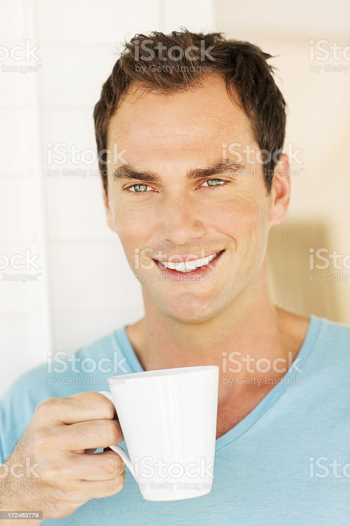Young Man Holding Coffee Cup royalty-free stock photo