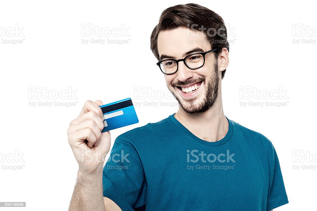Young man holding credit card stock photo
