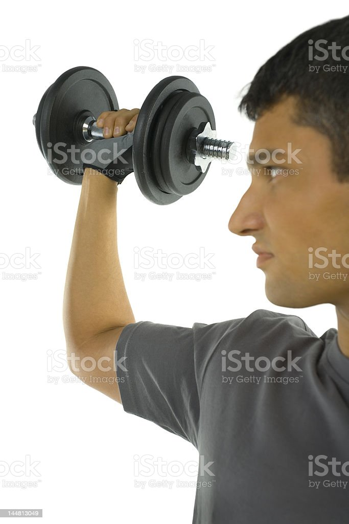 Young man holding dumbbell royalty-free stock photo