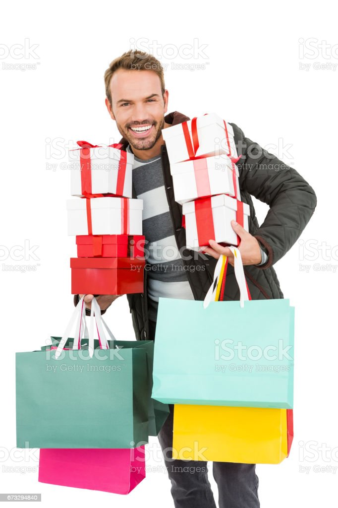 Young man holding gifts and shopping bags royalty-free stock photo