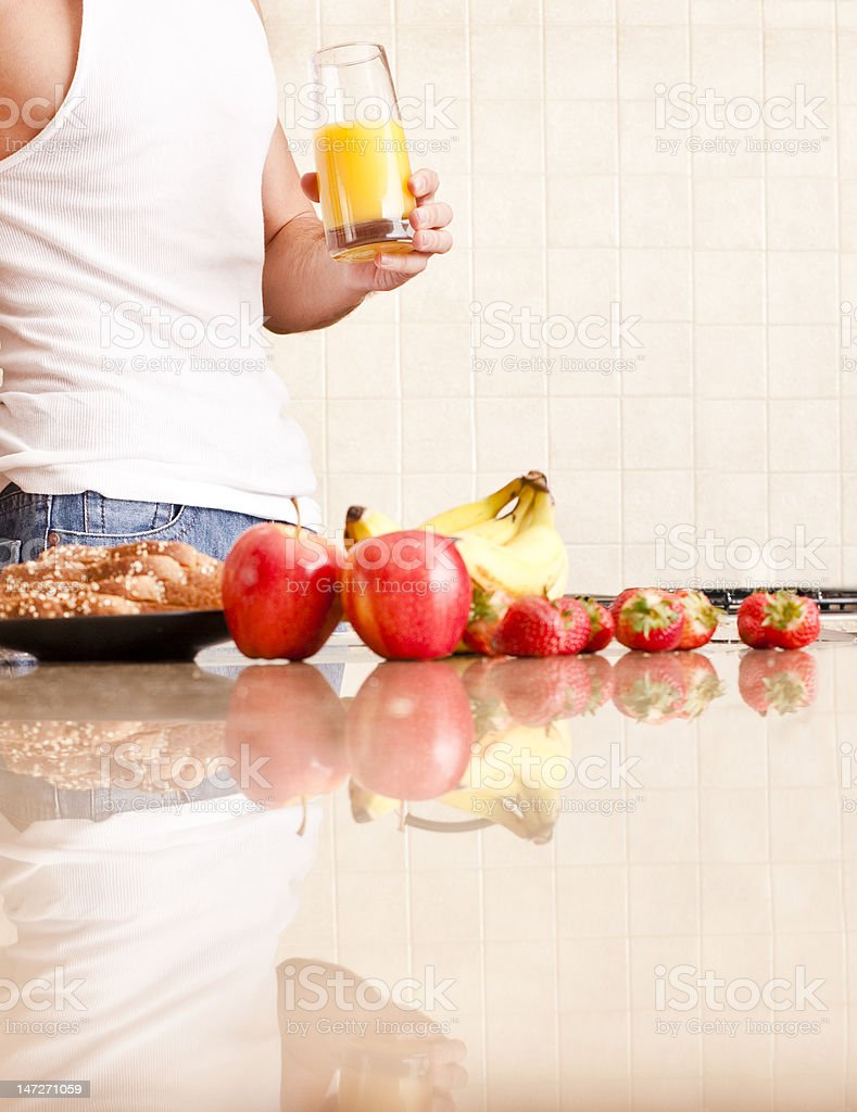 Young Man Holding Glass of Orange Juice royalty-free stock photo
