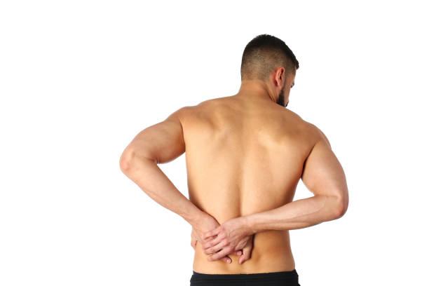 Junger Mann hält seinen Hals vor Schmerzen. Medizinisches Konzept – Foto
