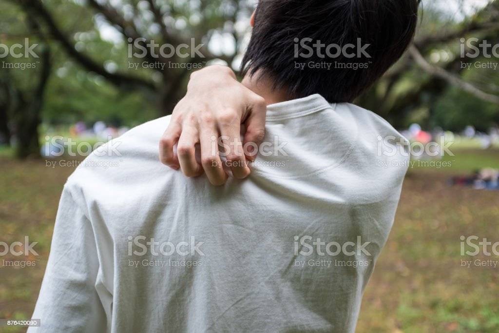 Young man holding his shoulder stock photo