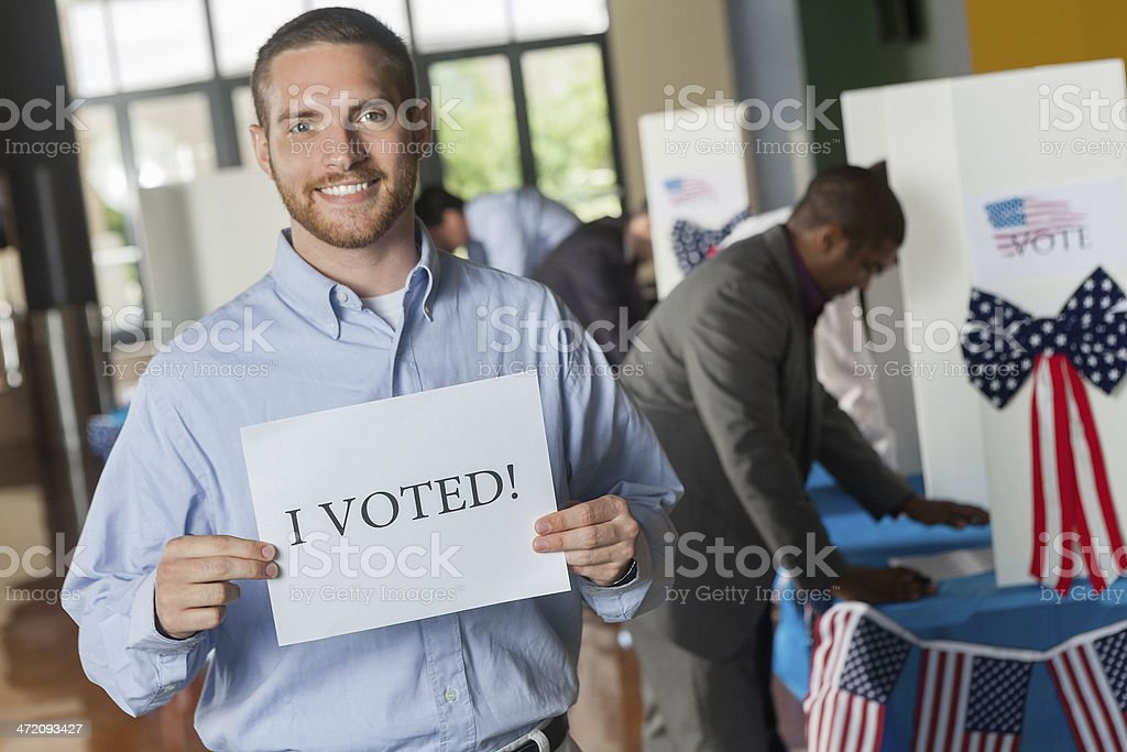Young man holding I voted sign on election day royalty-free stock photo