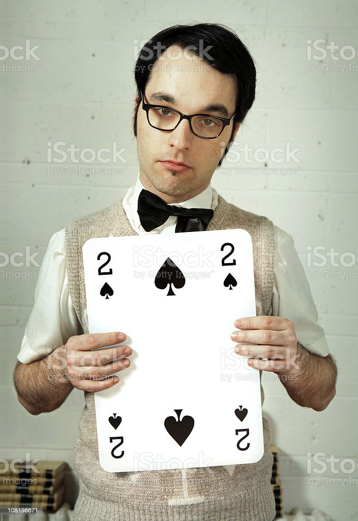 Young Man Holding Large Playing Card royalty-free stock photo