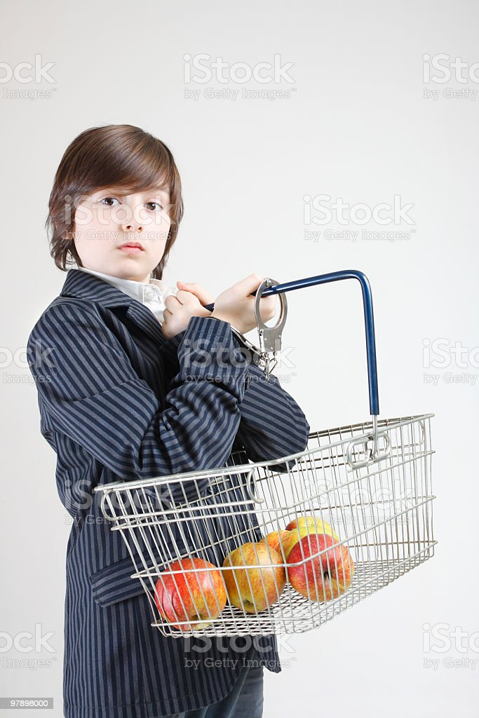 young man holding shopping basket with apples royalty-free stock photo
