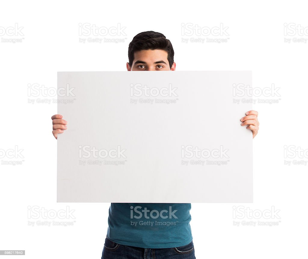 Young man holding sign and covering face foto royalty-free
