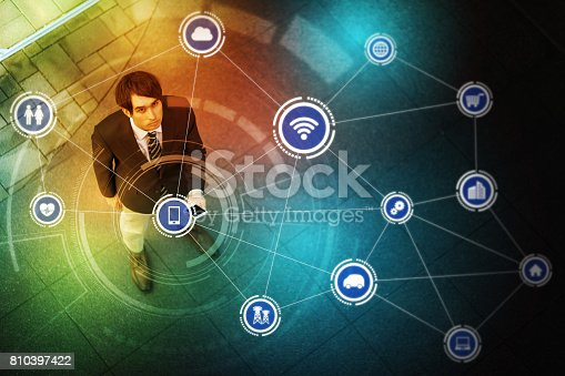 istock young man holding smart phone and Internet of Things concept 810397422