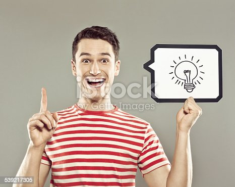 istock Young man holding speech bubble with light bulb 539217305