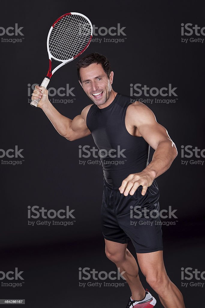 Young Man Holding Tennis Racket royalty-free stock photo
