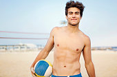 Young man holding volleyball